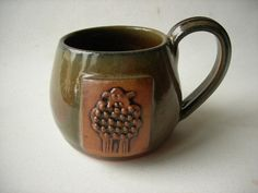 Mug with Sheep Motif by DragonPottery