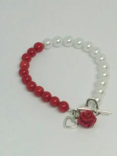 b5e1836d64cc Items similar to Red and White Beaded Bracelet with Red Rose and Heart  Charms on Etsy