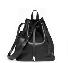 From the mind of PB 0110 design team member Ayzit Bostan, the AB16 bucket bag/shoulder bag is ultra lightweight (1 lb, 5 oz) and sports a clean, minimalist design. The leather comes from one of Europe...