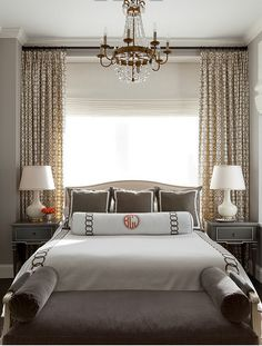 Bedroom Window behind Bed with Drapes in Pelagos Mist and Roman Shade and Sheer (Luxe Interiors) - June 22 2019 at Window Behind Bed, Curtains Behind Bed, Bedroom Drapes, Bedroom Windows, Home Decor Bedroom, Bedroom Ideas, Bed Against Window, Window Headboard, Open Window