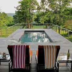Sleek Chic On a sloped property, it's possible to position an aboveground pool so that it looks like an in-ground one. A modern wood deck and high-end furniture add to the classy illusion.