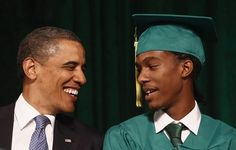 U.S. President Barack Obama talks with student Christopher Dean during a commencement ceremony in Memphis, Tennessee