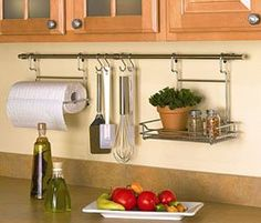 Curtain rod... with shower curtain hooks to hang up utensils in the kitchen! brilliant! for next to the stove