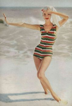 May Vogue 1957  Model is wearing a bathing suit in harlequin-diamond wool, by Imports.