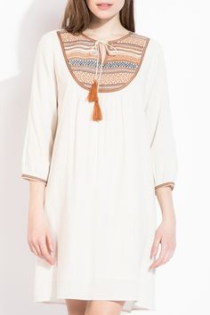 The combination of cream and camel brown adds a great warm touch to this bohemian THML peasant dress!