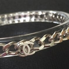 Amazing Chanel Clear Bangle w/Chain Inside. NEW!!! Brand new Chanel bangle! Clear resin with chain inside 3 Chanel logos circle the bracelet. Bangle has Chanel stamp inside. Gorgeous bracelet. Perfect gift. Brand new. Comes with Chanel pouch. Brand New but does not have tags. CHANEL Jewelry Bracelets