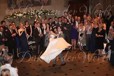 HAPPY TIMES AS JONATHAN SPINS HIS BRIDE CATE AROUND THE GREAT HALL DURING THEIR FIRST DANCE AT MATFEN HALL IN NORTHUMBERLAND, NORTH EAST ENGLAND