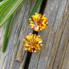 Precision faceted hexagon cut citrine gems set in 14k yellow gold.