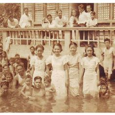 Manila flood in the Thirties. Fluffy white towels for the men, ankle-length ternos for the women.