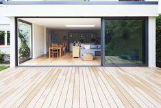 Wood decking pouting away from house for perception of length Balcony Doors, Patio Doors, Kitchen Diner Extension, Roof Extension, Aluminium Doors, House Extensions, Flat Roof, Open Plan Living, Sliding Doors