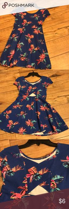 Skater dress/ Tunic Cute as can be with tropical flair, this dress is gently worn. No flaws that I can see.   Back has X  with cutouts. Good stretch for comfort.   Size Medium 7/8 Girls Dresses Casual