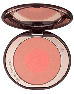"""Charlotte Tilbury Cheek to Chic Swish and Pop Blusher # Ecstasy. When it comes to blusher, I'm always seeking to re-create that shimmering, youthful flush of excitement you get when you're in love - my clients and I call it the """"love glow"""". I've spent many years perfecting this ultra-flattering look and now I've made it easy for anyone to achieve with CHEEK TO CHIC Swish & Pop Blusher. A 2-step application ritual, each shade is a creamy, colour-rich texture containing finely crushed…"""