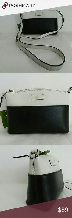 """KATE SPADE NEW YORK GROVE ST BLACK/CEMN LTH MILLIE KATE SPADE NEW YORK GROVE STREET MILLIE CROSSBODY/SHOULDER BAG!!  Style No WKRU4194  GORGEOUS BLACK/CEMENT ?LEATHER CROSSBODY/SHOULDER BAG  KATE SPADE NEW YORK PLAQUE ON FRONT  WATER AND STAIN REPELLANT  INTERIOR OPEN SLOT  ?KATE SPADE BLACK LOGO INTERIOR  ZIP TOP CLOSURE  EXTERIOR FRONT SLIP POCKET  KATE SPADE WHITE GOLD PLATED HARDWARE WITH KATE SPADE LOGO  ADJUSTABLE 42"""" STRAP  6 1/4""""H X 9""""L X 3""""W kate spade Bags Crossbody Bags"""