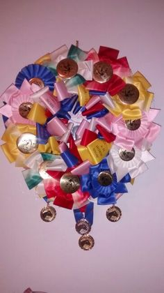 I made this wreath from only about 1/2 of the award ribbons and medallions my daughter earned at 4-H competitions. The center has one of her rodeo contestant numbers.