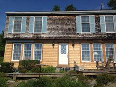 Little Switzerland house ! Tear down old Cedar shakes . Up with new Cedar lap siding .