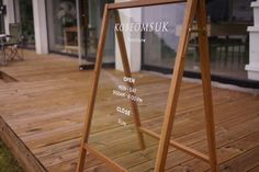 love this white ink + wood sidewalk sign design inspiration Store Signage, Wayfinding Signage, Signage Design, Web Banner Design, Shop Facade, Cafe Sign, Entrance Sign, Outdoor Signs, Environmental Design