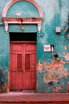 Merida, Mexico: the outside of these homes never look like much, but just wait 'till you open those doors...(As seen from watching too many episodes of House Hunters International!)