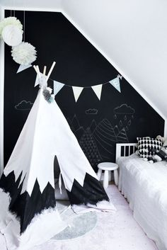 Black and white teepee. I love the monochromatic looks in kids rooms.