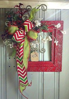 Who says you have to make a round wreath? Spray paint a reclaimed picture frame. Decorate with ribbon and trinkets. Merry Christmas!!