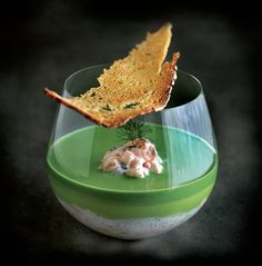 A large piece of salmon fillet is baked slowly and flaked into serving glasses with pickled cucumber and watercress mousse in this potted salmon recipe from Phil Howard - Great British Chef ! Phil Howard, Great British Chefs, Salmon Recipes, Food Design, Food Presentation, Food Plating, Food Inspiration, Food Photography, Food And Drink