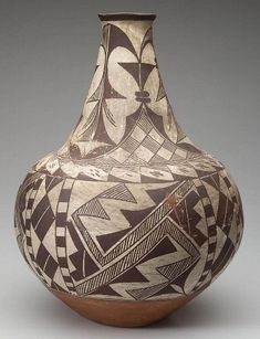 Native American Historic Acoma Pottery Jar 30. Description: NATIVE AMERICAN Historic ACOMA POTTERY JAR, bottle-form with black geometric decoration on a white ground, red band at base. Condition Repor