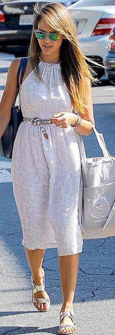Who made  Jessica Alba's gold flat sandals, green sunglasses, denim jacket, and jewelry?