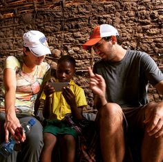 """April 7, 2015: """"Mark & Jodi Visser play with Neema, whose family benefits from sponsorship from donors through World Vision. Neema, her parents, siblings & community have had clean water since 2013."""" Photo by Chris Huber"""