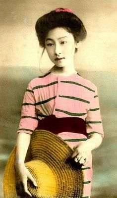 Vintage photograph of a young maiko in swimwear.
