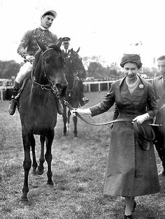 "The Queen | Queen Elizabeth leads her racehorse Carrozza ridden by jockey Lestor Piggott after winning 1967 ""The Oaks"" race at Epsom."