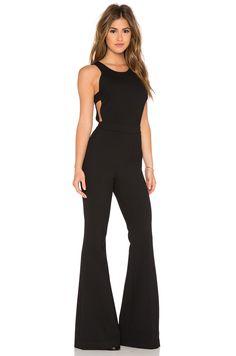 https://cdnd.lystit.com/photos/a370-2015/08/18/rachel-zoe-black-alli-jumpsuit-product-2-683086462-normal.jpeg