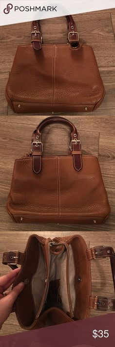 """Dooney & Bourke Purse Dooney & Bourke Purse: the bag is in excellent condition with no stains, markings, or tears. The dimensions are 10.5""""b, 7""""h, 2.5""""w. Dooney & Bourke Bags"""