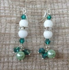 Handmade pendant earrings with ceramic pearls and Green cristals