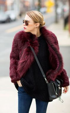 Marry a burgundy fur coat with dark blue skinny jeans for a casual level of dress. Shop this look for $217: http://lookastic.com/women/looks/fur-coat-oversized-sweater-crossbody-bag-skinny-jeans-sunglasses/4897 — Burgundy Fur Coat — Black Knit Oversized Sweater — Black Leather Crossbody Bag — Navy Skinny Jeans — Brown Leopard Sunglasses
