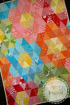 I'm naming this quilt a Mega Grandmother's Garden Quilt because it was inspired by the English Paper Pieced Grandmother's Garden Hexagon quilts. In this case, each hexagon is mad…