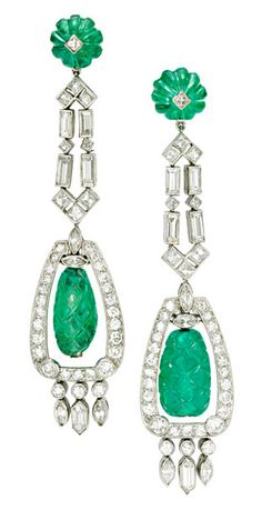 A Pair of Art Deco Emerald and Diamond Ear Pendants, each suspending a carved emerald fluted bead, within a diamond and navette-shaped diamond frame, to the baguette-cut diamond and emerald bead. Bijoux Art Nouveau, Art Nouveau Jewelry, Jewelry Art, Antique Jewelry, Vintage Jewelry, Fine Jewelry, Jewelry Design, Jewellery, Art Deco Earrings