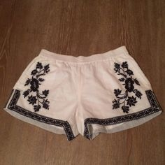 """J Crew White Embroidery Cotton Gauze shorts This is a re-posh. They are gorgeous. Price is firm unless you have them in a size 4 then I would gladly trade you!       Elastic waist.Slant pockets. Machine wash. Low rise. 3"""" inseam. Sits above hip. J. Crew Shorts"""