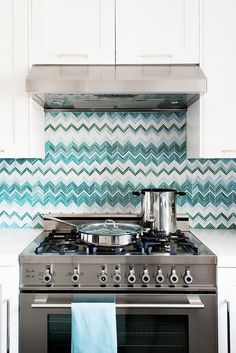 Awesome Missoni looking zig zag backsplash made with Ann Sacks tile