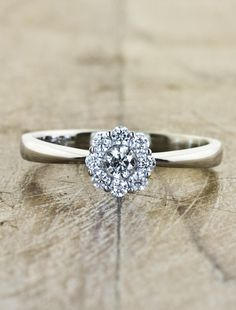 This would be sweet to surround my grandmas diamond with other diamonds but i think I'd want a thinner band made of tiny diamonds lol