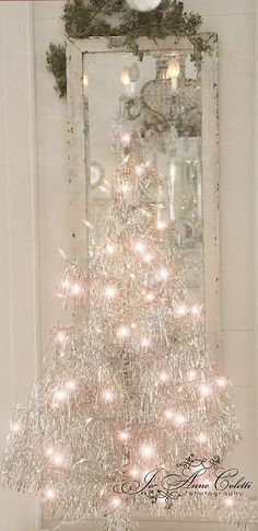 Silver Christmas tree with soft white lights for decoration Noel Christmas, Pink Christmas, Country Christmas, Winter Christmas, Christmas Lights, Silver Tinsel Christmas Tree, Xmas, Shabby Chic Christmas, Victorian Christmas