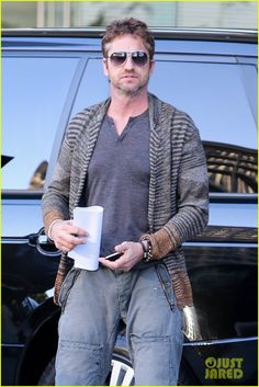 : Photo Gerard Butler smiles for the cameras as he parks his car and heads inside an office building on Thursday (January in Beverly Hills, Calif. Hot Actors, Actors & Actresses, Male Celebrities, Celebs, London Has Fallen, Poster Boys, Men In Kilts, Gerard Butler, Haircut Styles