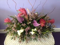 Tropical centerpiece with pink Ginger and lavender Antheriums