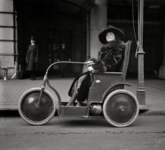 """Jan. 22, 1922. Washington, D.C. """"Woman in three-wheeled vehicle."""" The electric chair last spied here. Harris & Ewing glass negative"""