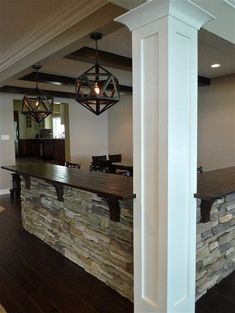 Stone Bar with wood top. I like how it is built around the support post. #basementbar