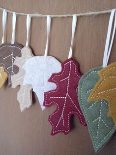 Felt Fall Leaves - cut out leaves, stitched veins. Attached leaves to natural jute string. Used yellow, gold, orange, and soft green felt. Hung from mantle. Fabric Crafts, Sewing Crafts, Diy Crafts, Paper Crafts, Autumn Crafts, Holiday Crafts, Fall Felt Crafts, Felt Leaves, Felt Decorations