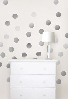 Easily removable silver confetti decals for your walls.