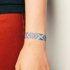 friendship bracelet tattoos. this site has so many cute tattoo designs and really cute ones for kids too