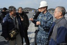 YOKOSUKA, Japan (Jan. 30, 2014) Lt. Cmdr. James Stockman, public affairs officer of the aircraft carrier USS George Washington (CVN 73), left, explains flight deck operations to officers from the Asaka Police station during a ship tour. (U.S. Navy photo by Mass Communication Specialist 2nd Class Peter Burghart/RELEASED)