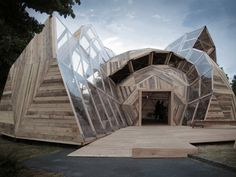 Canadian architects Kristoffer Tejlgaard and Benny Jepsen have slightly altered the mathematical elements of a geodesic dome to form a new modular pavilion. The façade's curved surfaces are covered with recycled wood panels, creating opaque faces.