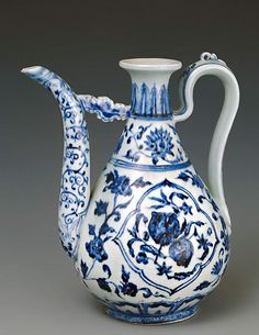Wine ewer decorated with flowers and fruits Ming dynasty, Yongle period, 1403 � 1425 Porcelain with underglaze blue decoration height 26....