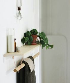 Towel rack shelf: For the shelf, you'll need a wood board, a dowel, flat braces, and tubing hooks. This particular shelf is minimalist, but if you want to go bold, try painting it in a bright hue or a shade that matches your shower curtain or rug.